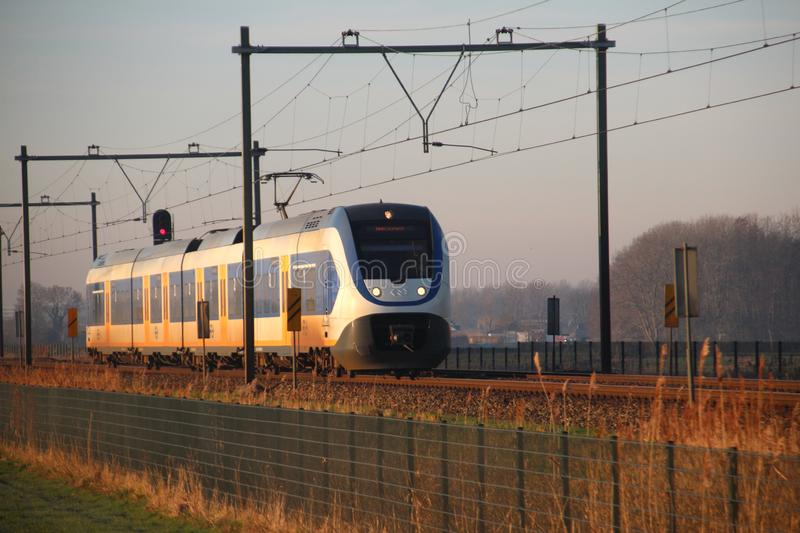 SLT sprinter local commuter train in the evening sun between gouda and Rotterdam in Moordrecht. royalty free stock image