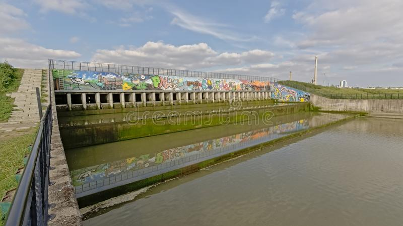 Sluice on a side-arm of river Scheldt in Antwerp. Sluice on a tributary of river Scheldt in Antwerp, part of the Sigmaplan infrastructure which protects Flanders royalty free stock photography