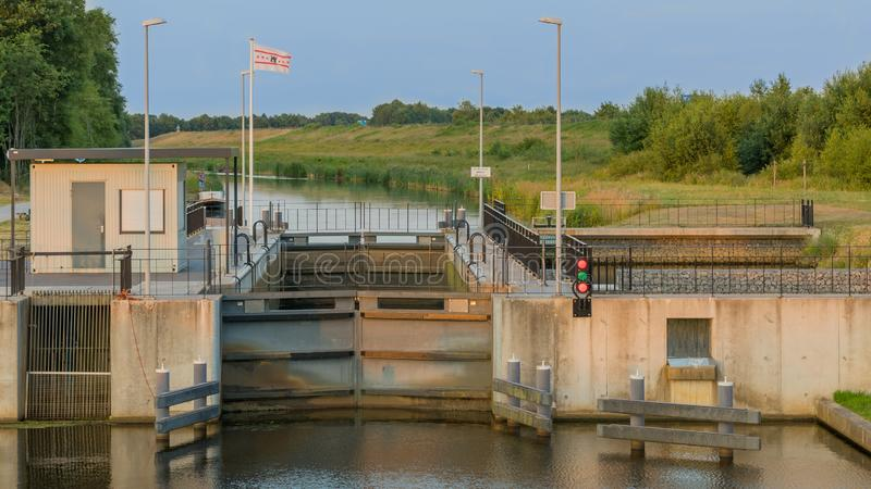 Sluice water lock in Drenthe Netherlands royalty free stock photography