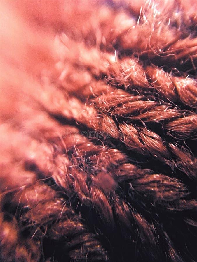 Sluit bruin breien omhoog stof royalty-vrije stock afbeelding