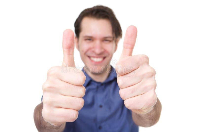 Sluit de omhoog glimlachende mens die twee duimen tegenhouden royalty-vrije stock foto