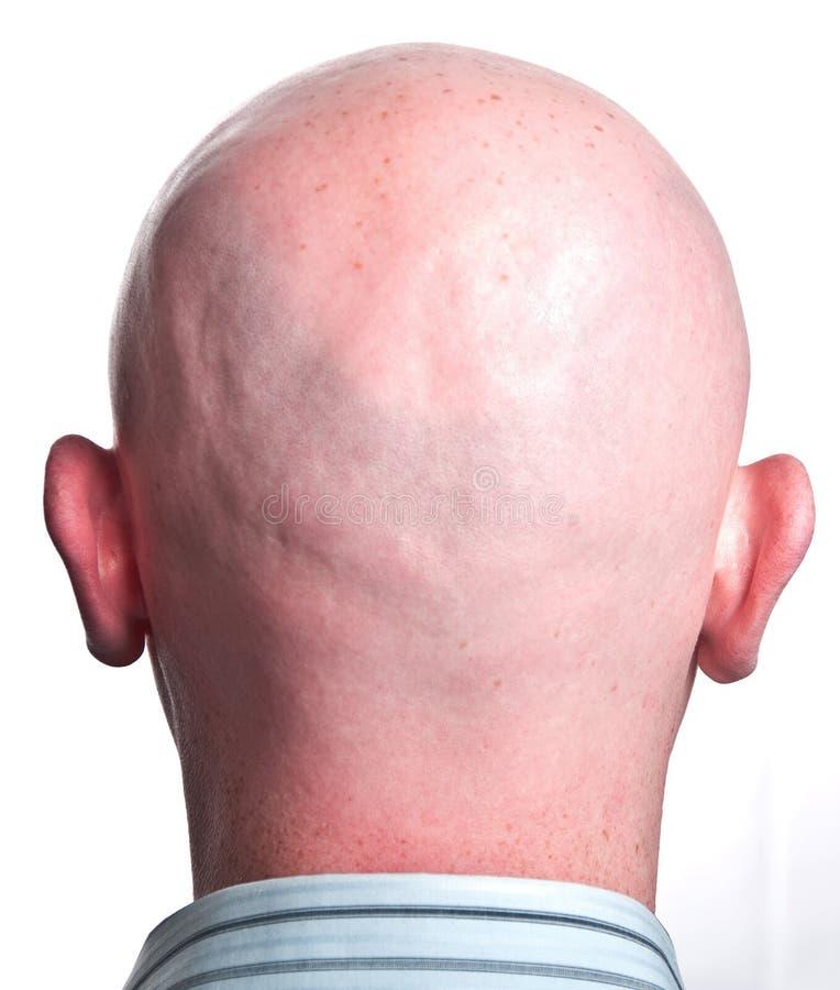 Sluit mannetje omhoog geschoren kaal hoofd stock afbeeldingen
