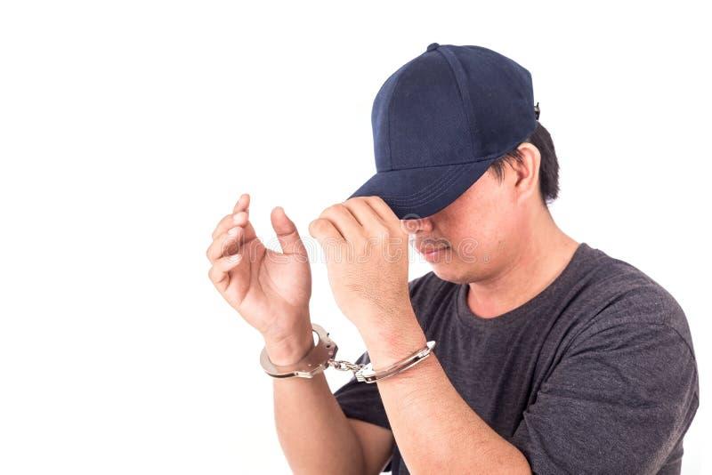 Sluit mens met handcuffs op handen op witte backgroun omhoog wordt de geïsoleerd die stock foto's