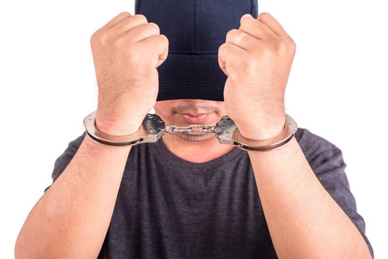 Sluit mens met handcuffs op handen op witte backgroun omhoog wordt de geïsoleerd die stock afbeeldingen