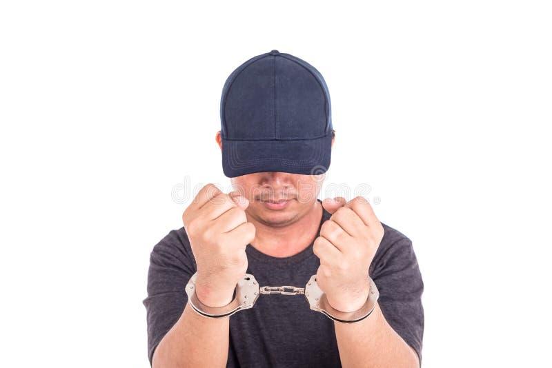 Sluit mens met handcuffs op handen op witte backgroun omhoog wordt de geïsoleerd die royalty-vrije stock foto's