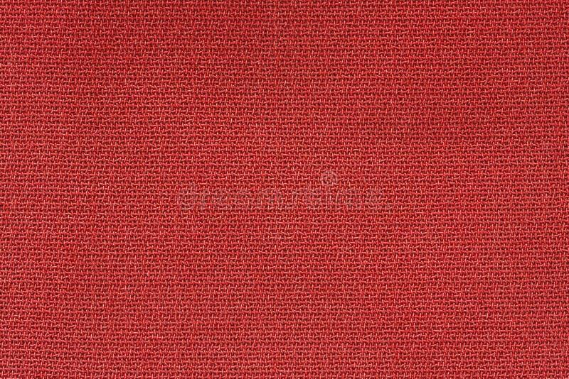 Sluit omhoog Achtergrondpatroon van rode Textieltextuur, de Abstracte textuur van het kleuren textiel netto patroon stock foto