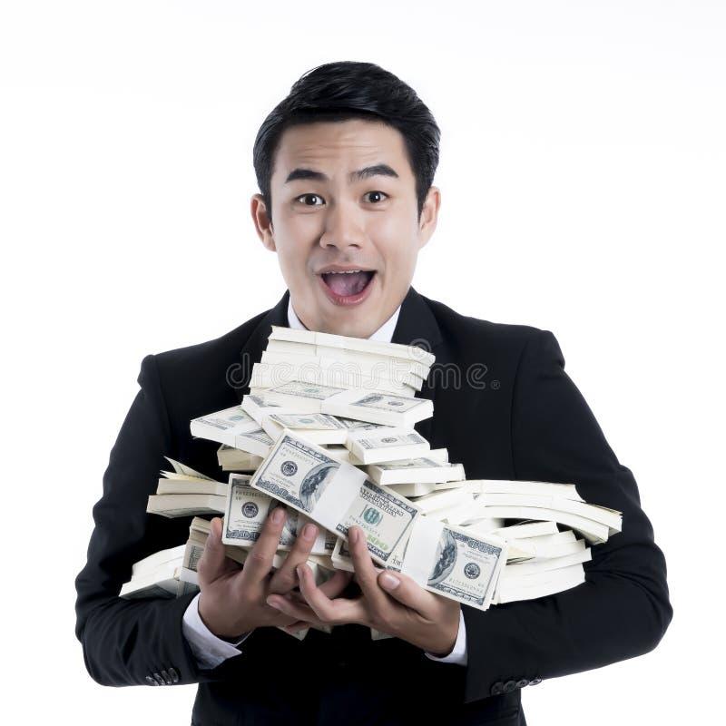 Sluit omhoog de jonge zakenman die een grote stapel van bankbiljet dragen royalty-vrije stock foto's