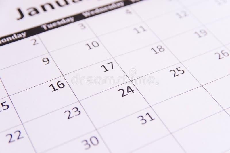 Sluit omhoog de paginaachtergrond van de bureaukalender met exemplaarruimte stock afbeeldingen