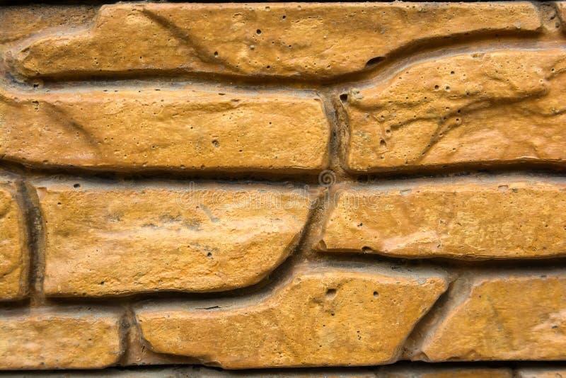 Sluit omhoog decoratieve bakstenen muurachtergrond royalty-vrije stock afbeelding