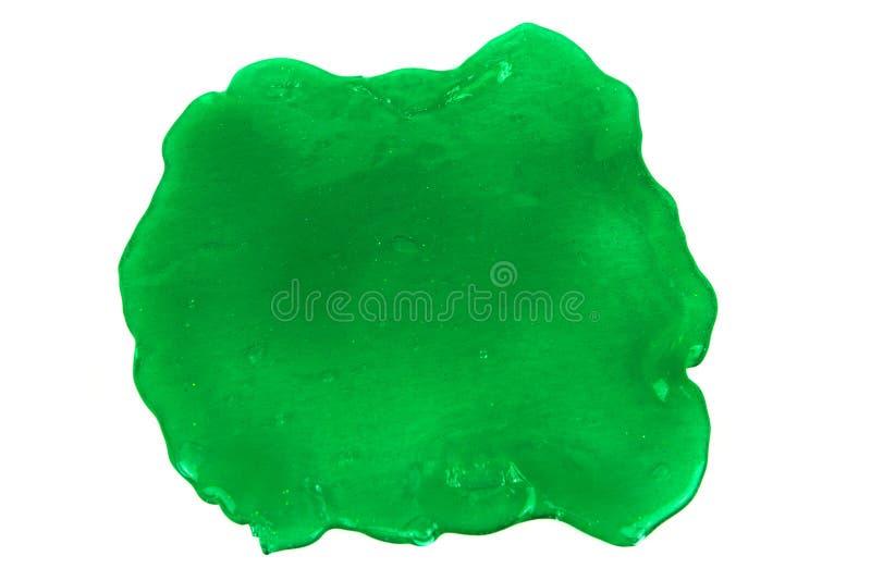 Sluit omhoog foto van groene die slijmvlek op witte achtergrond wordt geïsoleerd stock foto