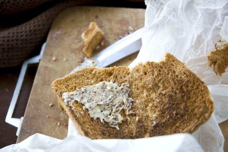 Sluit omhoog geroosterd met boter stock foto
