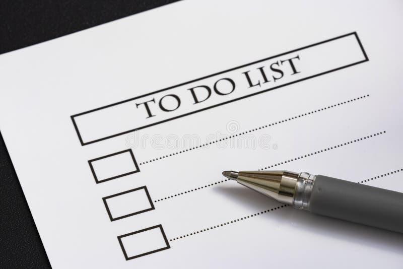 Sluit omhoog het document van de herinneringsnota en om lijst te doen royalty-vrije stock afbeelding