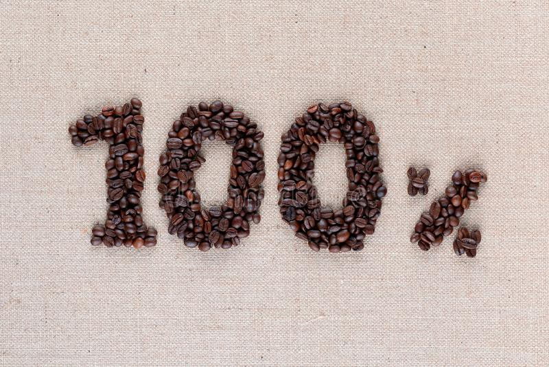 Sluit 100%-omhoog korting van koffiebonen stock foto's
