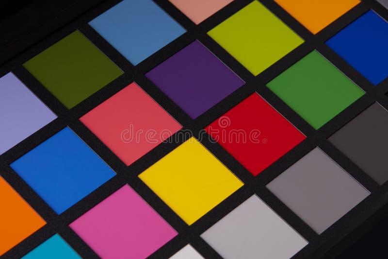 Sluit omhoog mening van het materiaal van de kleurencontroleur van professionele fotograaf stock foto's