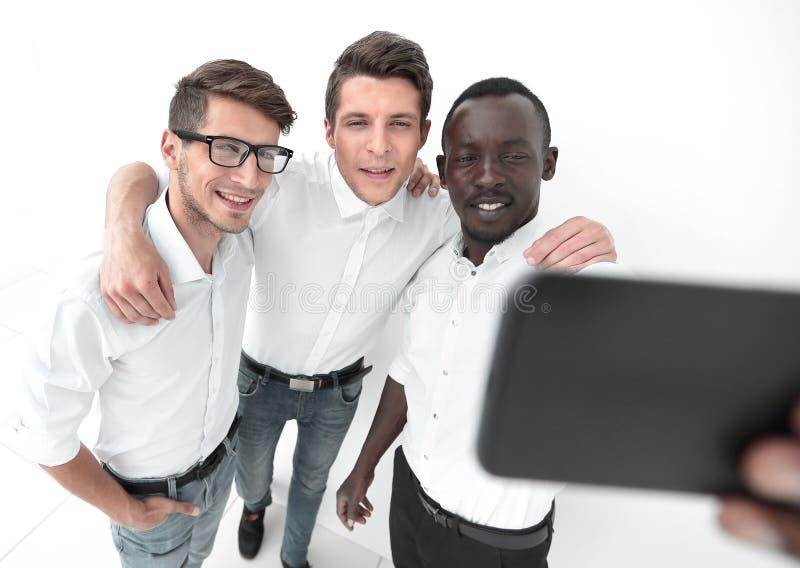 Sluit omhoog multinationaal commercieel team die selfies nemen royalty-vrije stock foto
