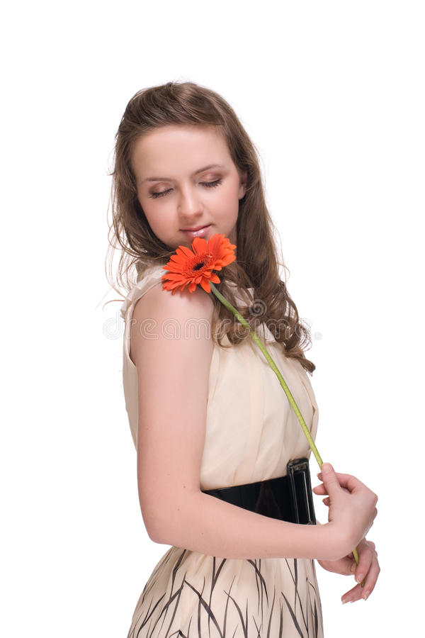 Sluit omhoog portret van mooie vrouw met bloem royalty-vrije stock foto