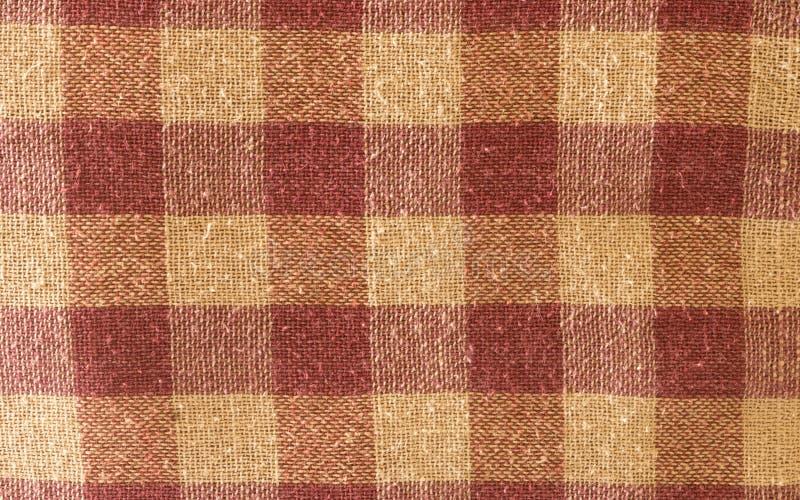 Sluit omhoog samenvatting van de blok gecontroleerde vorm van de katoenen achtergrond drukstof Naadloze kleurrijke doek textielte stock fotografie