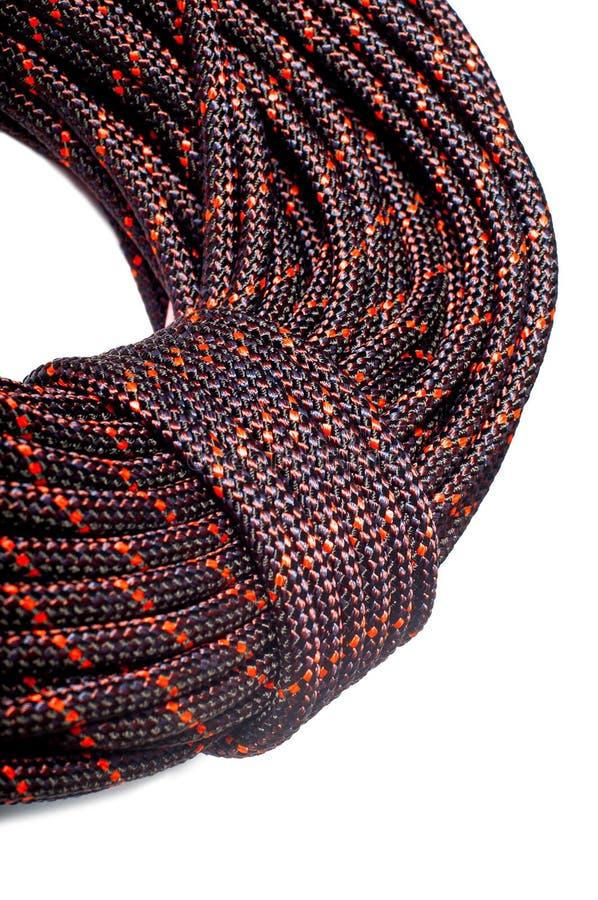 Sluit omhoog van bocht van kabel gebruikend in Beklimmen geïsoleerd op witte bedelaars stock foto's