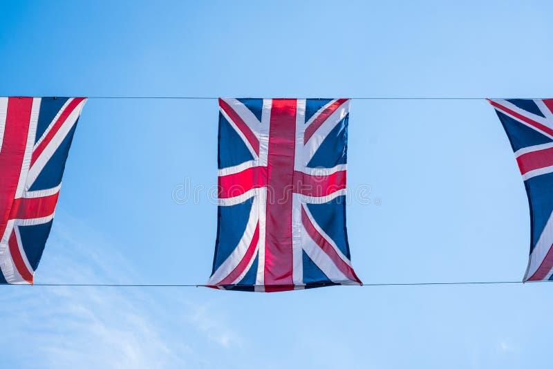 Sluit omhoog van Britse vlaggen die in Regent Street London vliegen het Koninklijke Huwelijk van Prins Harry aan Meghan Markle te royalty-vrije stock afbeeldingen