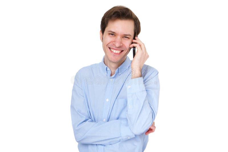 Sluit omhoog van de gelukkige bedrijfsmens die en zich op telefoon bevinden spreken stock fotografie