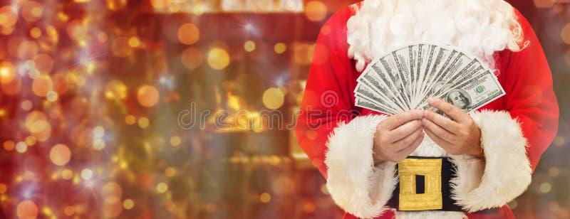 Sluit omhoog van de Kerstman met dollargeld stock afbeelding