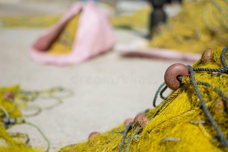Sluit omhoog van een geel visnet royalty-vrije stock foto's