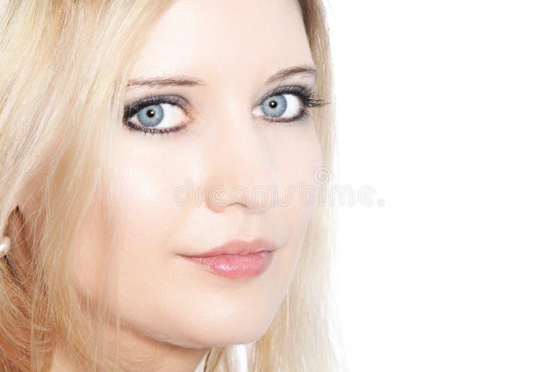 Sluit omhoog van een mooie blonde haired vrouw stock fotografie