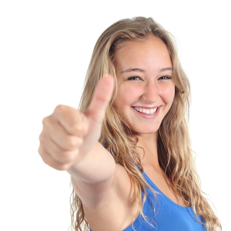 Sluit omhoog van een mooie tiener met omhoog duim royalty-vrije stock foto