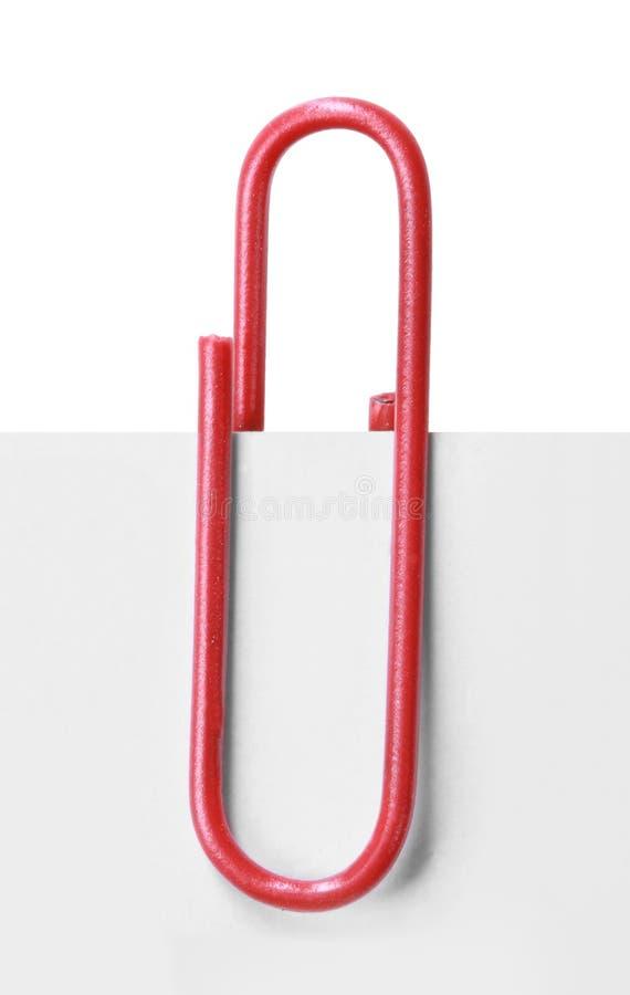 Sluit omhoog van een rode paperclip stock afbeeldingen