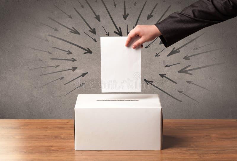 Sluit omhoog van een stembus en een beslissende stem stock fotografie