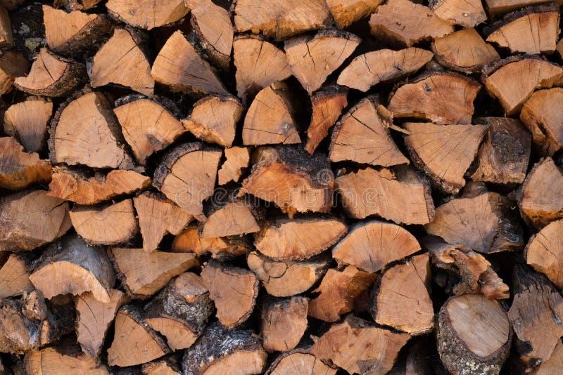 Sluit omhoog van gehakte logboeken voor brandhout achtergrondtextuur royalty-vrije stock foto