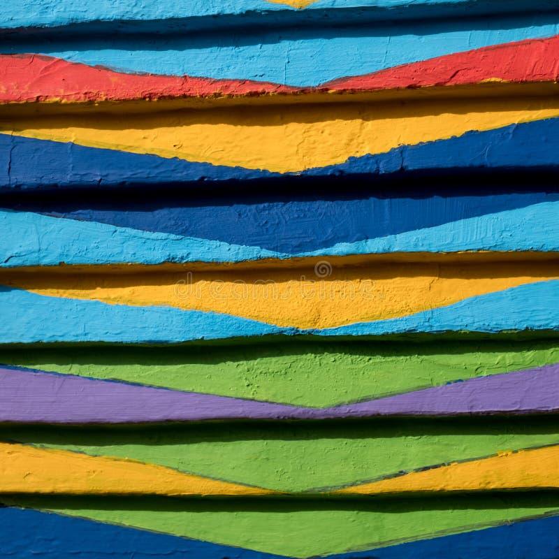 Sluit omhoog van helder, gevormd verfwerk op huis op het Eiland Burano, Venetië, Italië stock fotografie