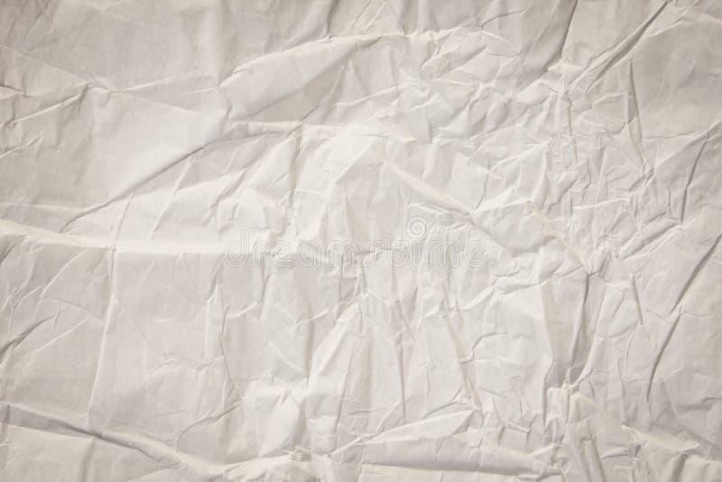 Sluit omhoog van het document van de rimpeltextuur glanzend blad licht gestemd art. royalty-vrije stock fotografie