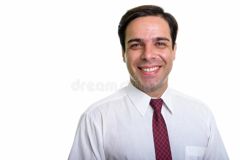 Sluit omhoog van jonge gelukkige Perzische zakenman die ge?soleerde aga glimlachen royalty-vrije stock afbeelding