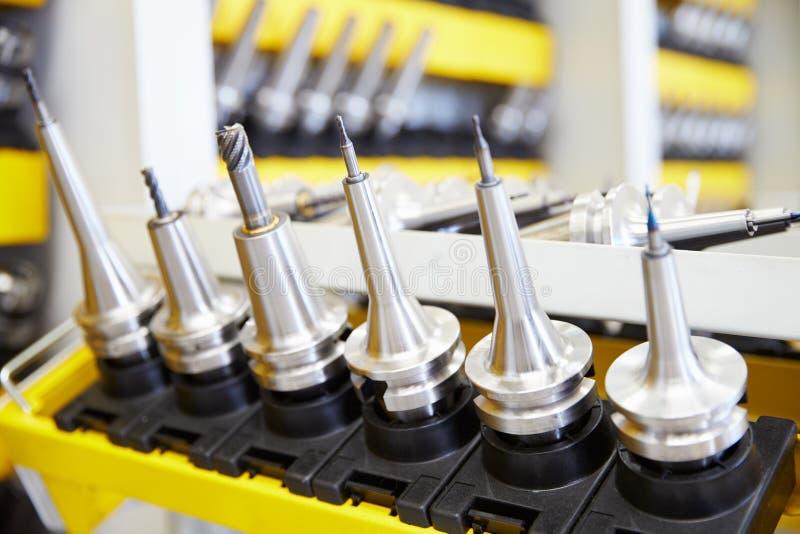Sluit omhoog van Precisiehulpmiddelen op CNC Machines worden gebruikt die stock afbeelding