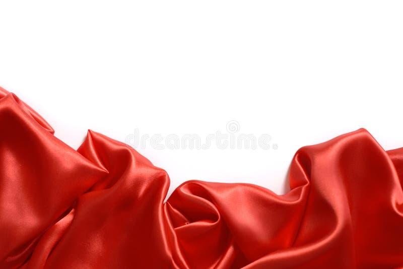 Sluit omhoog van rimpelingen op rode zijdestof Satijn textielachtergrond royalty-vrije stock fotografie