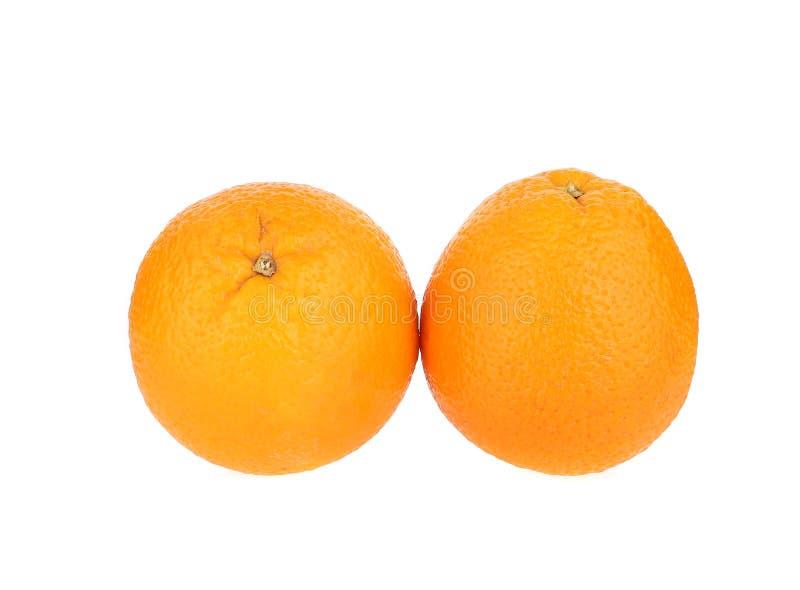 Sluit omhoog van twee rijpe sinaasappelen stock afbeelding