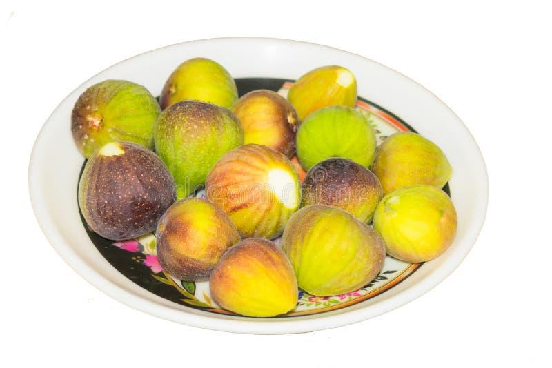 Sluit omhoog van vers geïsoleerd fig.fruit stock afbeelding