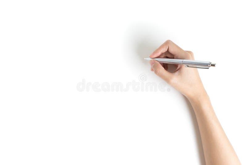 Sluit omhoog van vrouwenwapen schrijvend met metaalpen Geïsoleerd op whi royalty-vrije stock afbeelding