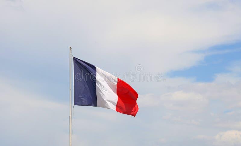 Sluit omhoog vlag van Frankrijk die in de wind golven stock foto's