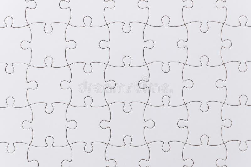 Sluit omhoog witte puzzeltextuur royalty-vrije stock afbeeldingen
