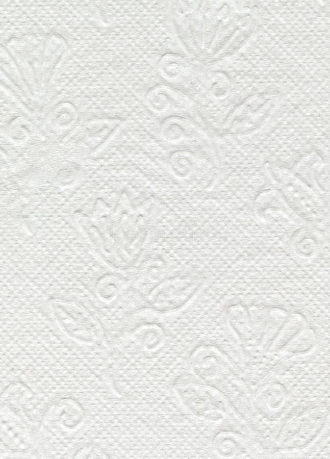 Sluit omhoog witte toiletpapiertextuur Wit geweven WC-document met bloemenornament stock fotografie
