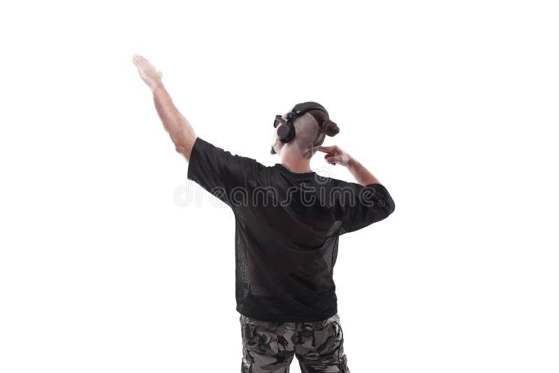 Sluit omhoog Zachte nadruk modieuze rapper verschijnt op exemplaarruimte stock foto's
