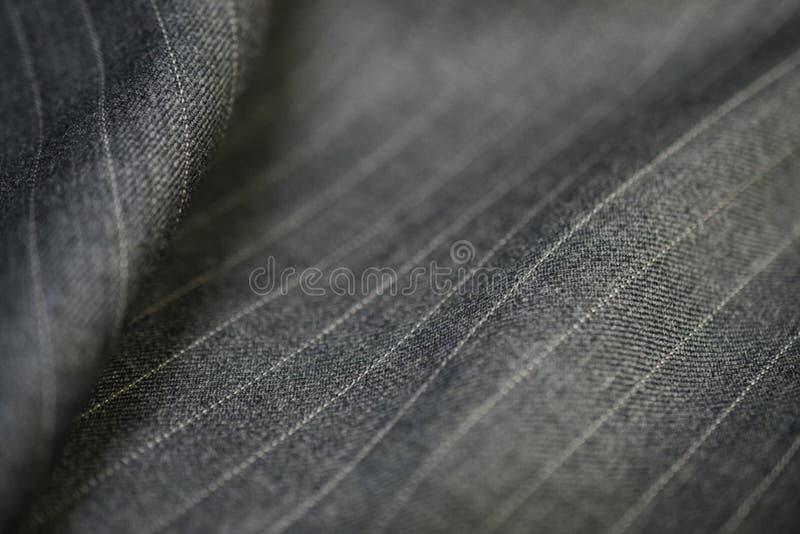 Sluit omhoog zilveren textuurstof van kostuum stock afbeelding