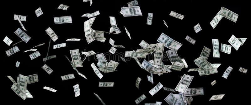 Sluit van ons omhoog dollargeld die over zwarte vliegen stock fotografie