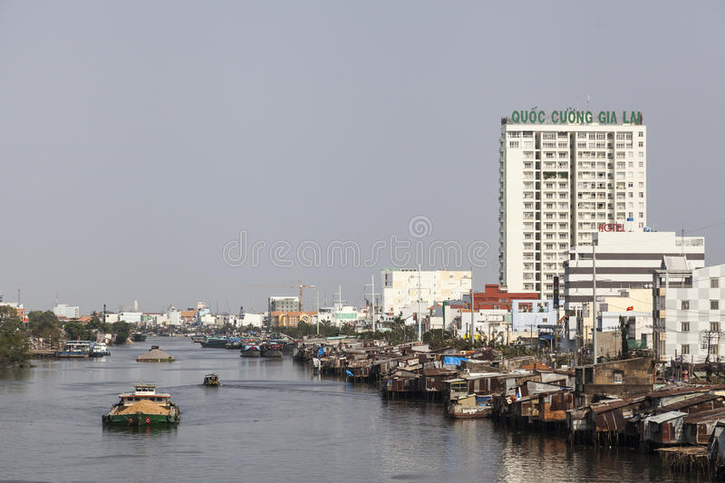 Slum on the bank of Saigon river. Poorest people in Ho Chi Minh city in Vietnam line in the slum on the bank of Saigon river royalty free stock images