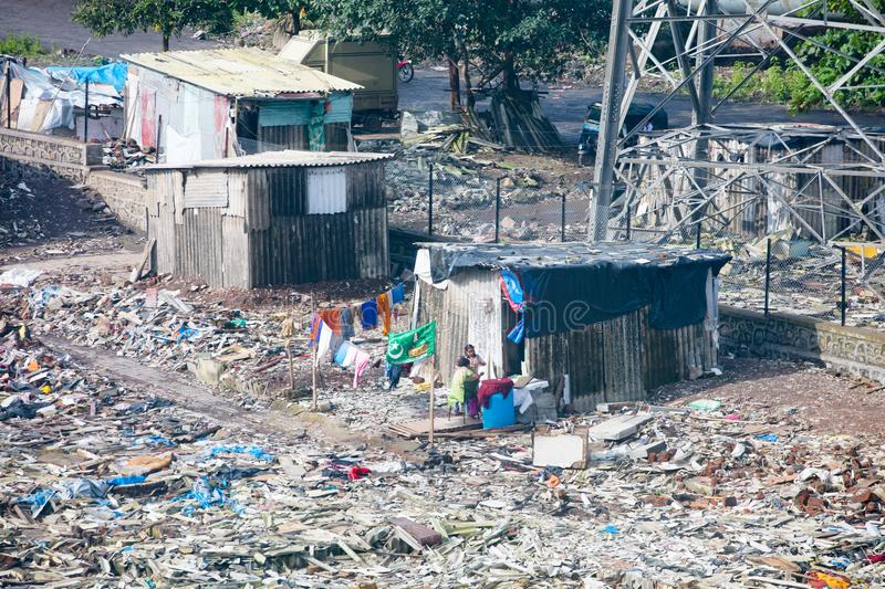 Mumbai Slum Development. A slum being destroyed by developers near a business park in the district of Airoli in Mumbai, India royalty free stock photos