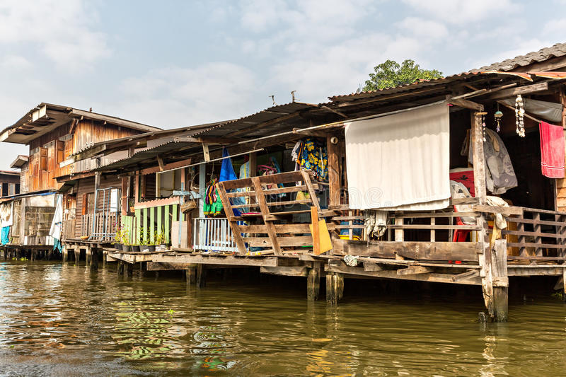 Slum on dirty canal in Thailand. Shanty-town near lake in Asia stock image