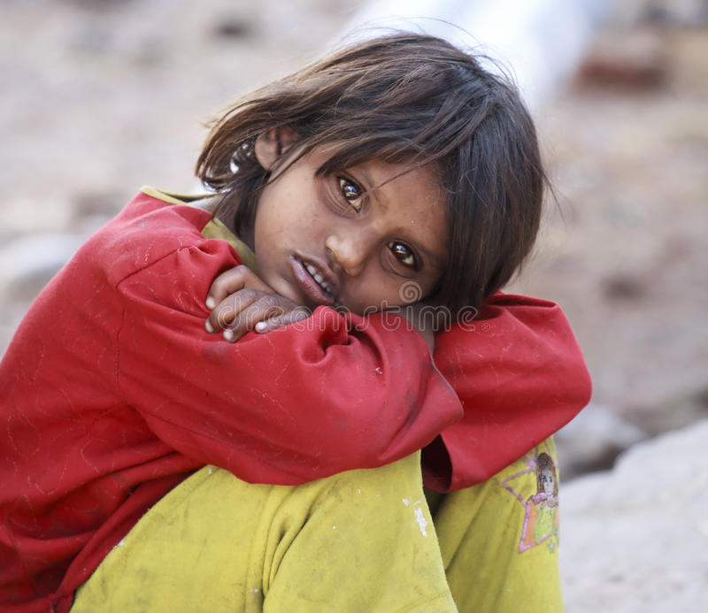 Slum India – Dharamshala. Little dirty and poor girl begging money and food at the entrance of the residence of the Dalai Lama in Tibetan areas stock photography