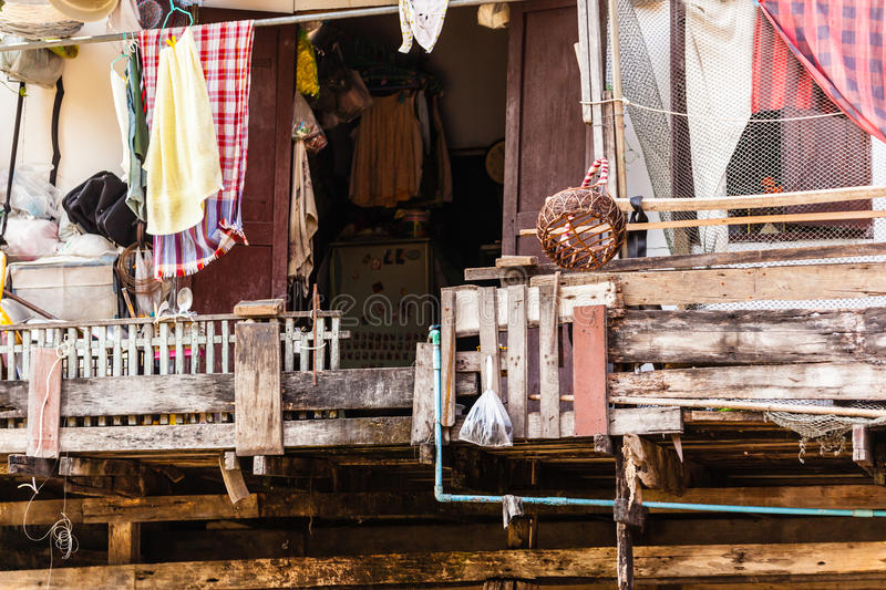 Slum. Wooden slums on stilts on the riverside of Chao Praya River in Bangkok, Thailand royalty free stock photo